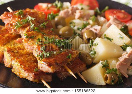 Spanish Pork Kabobs - Pinchos Morunos And Potatoes Salad Closeup. Horizontal