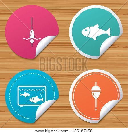 Round stickers or website banners. Fishing icons. Fish with fishermen hook sign. Float bobber symbol. Aquarium icon. Circle badges with bended corner. Vector