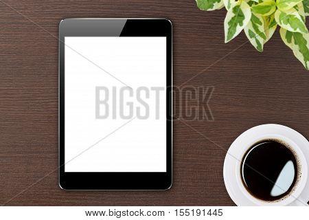 digital tablet blank screen on wood top view