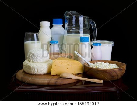 Still life of dairy products on dark background
