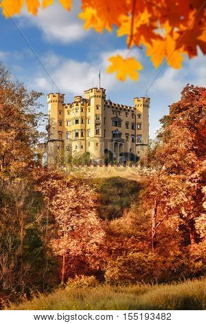 Famous Hohenschwangau castle with autumn leaves in Bavaria Germany