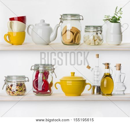 Various food ingredients and utensils on kitchen shelves isolated