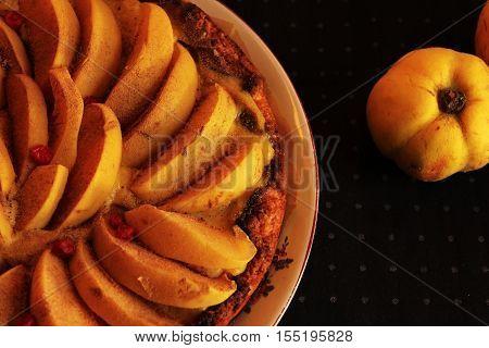 flan quince shortcrust pastry with custard dark background
