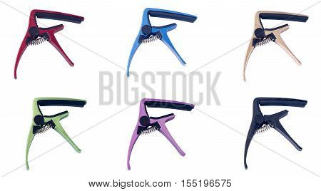 colorful guitar capo on white background, close up