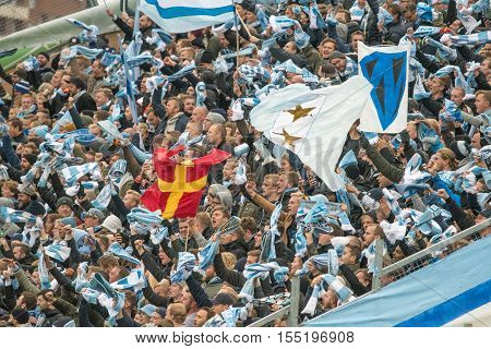NORRKOPING, SWEDEN - OCTOBER 31, 2016: Malmo FF supporters at an away game. Mamo FF won the Swedish football championship in 2016 and their supporters are among the most loyal in Sweden.