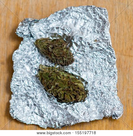 Close Up On Marijuana In Tin Foil On Table