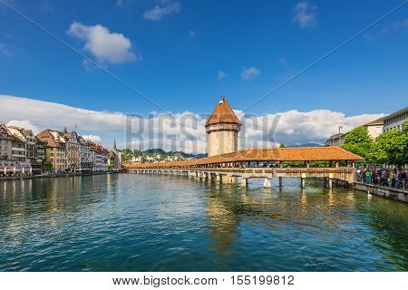 Lucerne Switzerland - May 24 2016: Architecture of Lucerne. Chapel Bridge & Water Tower Reuss river and the ancient city of Lucerne Switzerland.