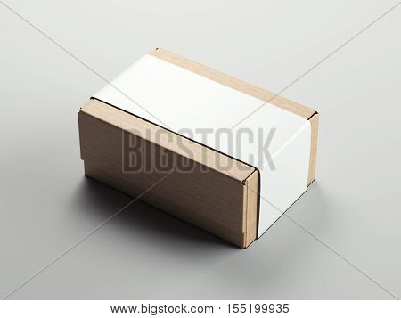 Cardboard package with blank white sticker on a white floor. 3d rendering