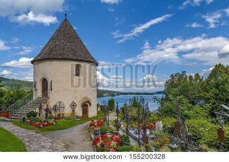 Tower and cemetery in Maria Worth Carinthia Austria