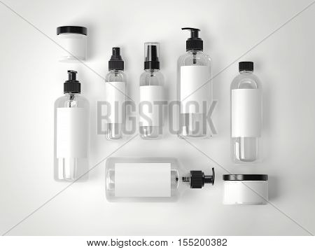 Set of beauty cosmetic plastic containers on a white floor. 3d rendering