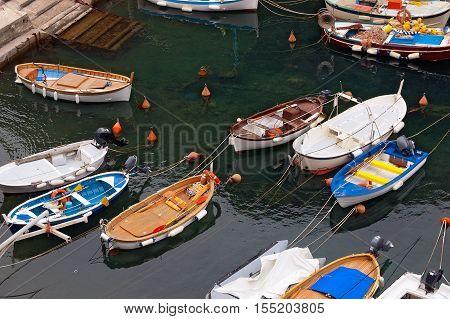 Many small fishing boats with fishing equipment docked in the port - Framura La Spezia Liguria Italy