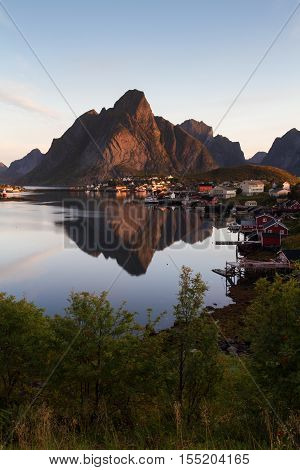 Village of Reine with mountain reflection Lofoten Norway
