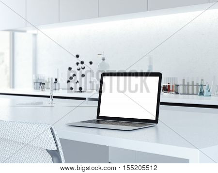 Opened laptop on a laboratory desk in clean interior. 3d rendering
