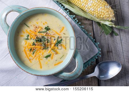 yellow sweet corn chowder soup in blue bowl