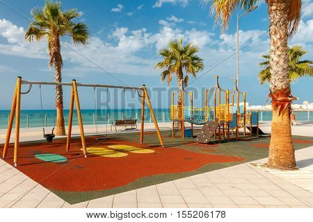 Children colorful playground on the waterfront of Cadiz. Spain. Andalusia.