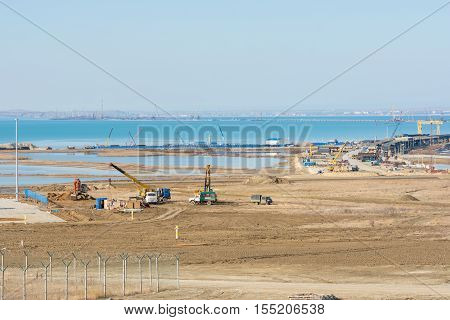 Taman, Russia - November 5, 2016: Construction Of A Bridge Across The Kerch Strait, A View Of The Co