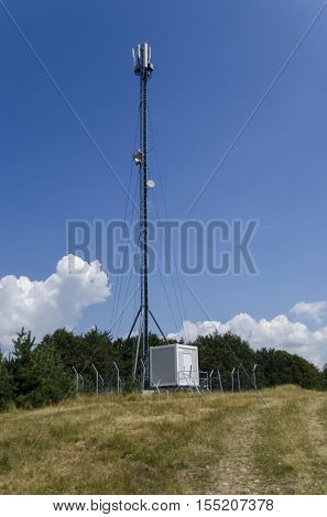 Telecommunication tower with antenna of advance summer, Plana mountain, Bulgaria