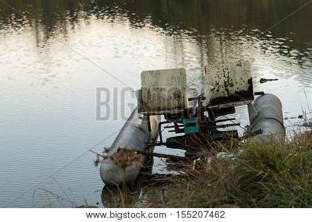 Abandoned Pedalo Cycle Boat In Lake