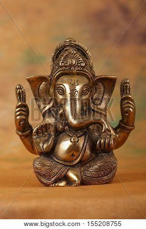 Hindu deity ganesh on a ohm made of brass.