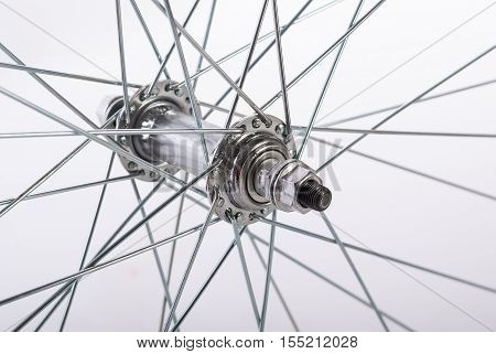 Part of bicycle wheel with spokes on a white background.