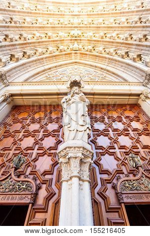 BARCELONA, SPAIN - AUGUST 25, 2016: Fragment of Cathedral of the Holy Cross and Saint Eulalia in Barcelona, Spain. Detail of the entrance door.