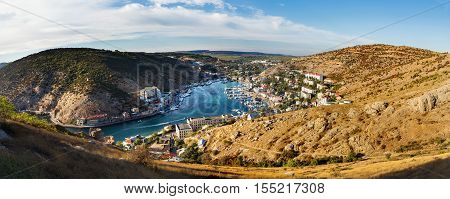 Panorama view of Balaclava from the ancient fortress Chembalo. Balaclava Bay with yachts in bright sunny day. Crimea Rusiia.
