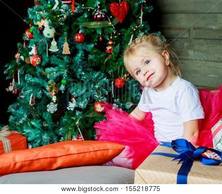 happy child with Christmas tree and presents in bed at home
