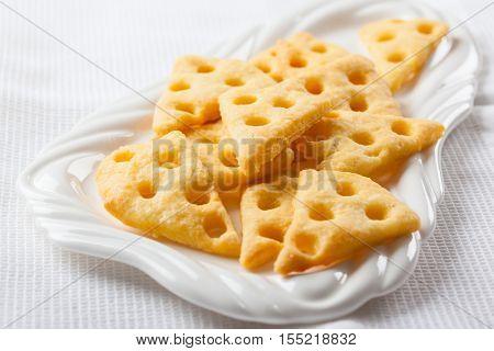 Homemade cheese crackers on white