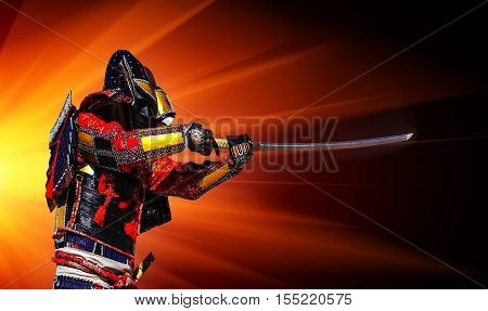 Samurai in ancient armor with a sword ready to attack at sunset.
