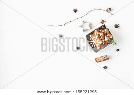 Christmas composition. Gift larch branches cinnamon sticks anise star christmas cookies. Flat lay top view