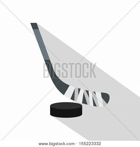 Hockey stick and puck icon. Flat illustration of hockey stick and puck vector icon for web design