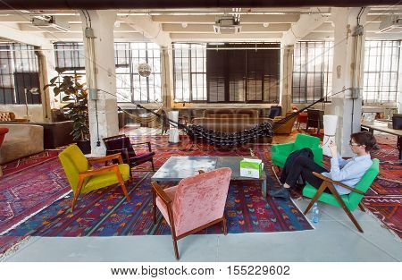 TBILISI, GEORGIA - OCT 8, 2016: Loft style hotel lobby with vintage furniture chairs and carpets inside on 8 October, 2016. The annual number of tourists in Georgia reached 2300000 people