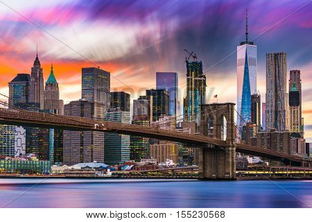 New York City skyline with the Brooklyn Bridge and Financial district on the East River.