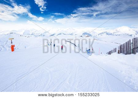 View to Tyrolian Alps and ski slopes in Austria from famous Kitzbuehel ski resort with 54 cable cars 170 km prepared skiing slopes and place of famous Hahnenkamm races.