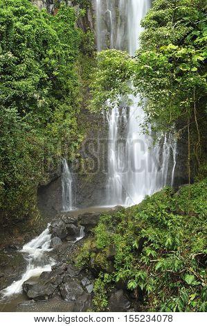 Tropical rain forest waterfall on the road to Hana, Maui, Hawaii