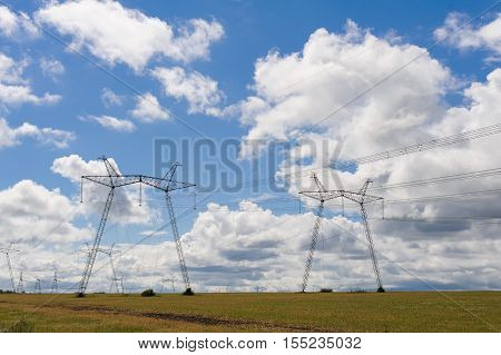 High voltage power line against sky. Electrical tower on a background of cloudy sky.