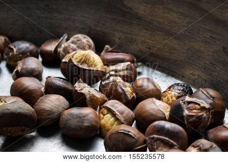 Background of roasted chestnuts seasonal street food