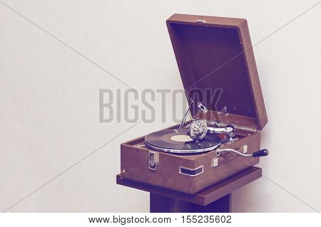 Old retro portable gramophone isolated vintage style toned with empty space