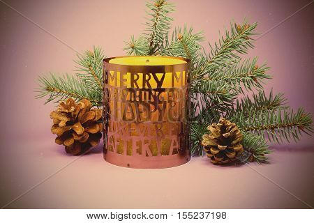 Christmas candle and bumps on a purple background