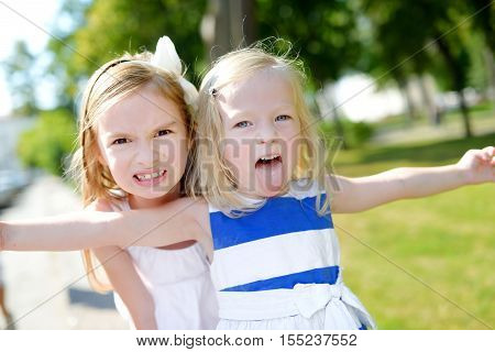 Two Sisters Making Funny Faces Outdoors