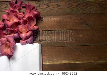 Open book on table. The flower on a background of book. Back to school. Copy space