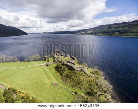The famous lake Loch Ness aerial shot green Scotland United Kingdom