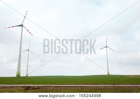 Energy wind turbines on field