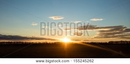 Sunset on sky with puffy clouds