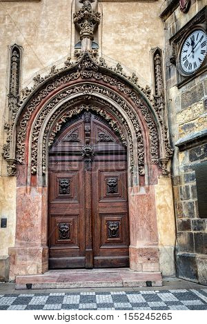 Old gate in baroque style with lion heads in Prague