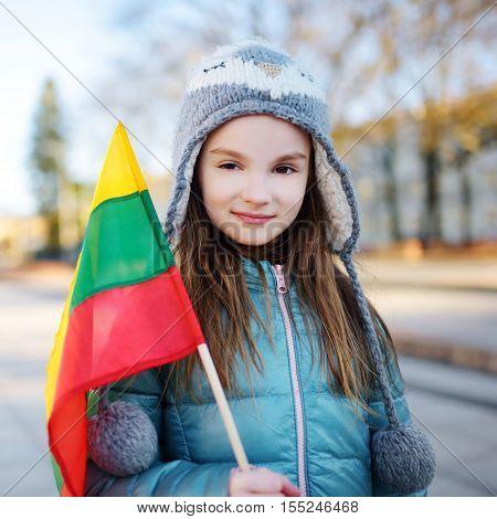 Cute Little Girl Holding Lithuanian Flags In Vilnius