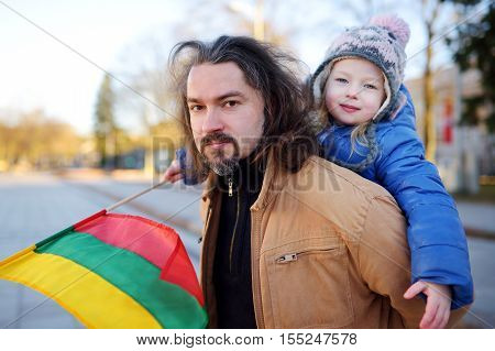 Father And Daughter With A Flag On Lithuanian Independence Day