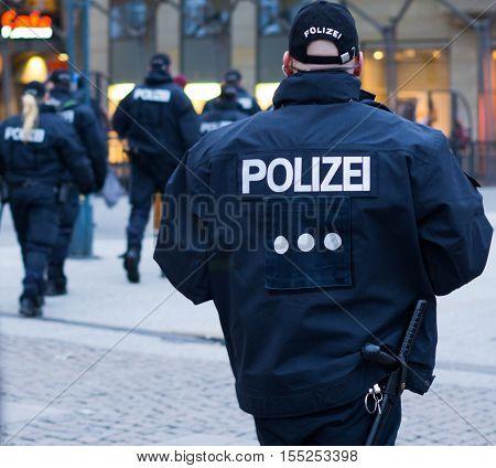 Hamburg, Germany - November 04, 2016: Policemen patrolling in Rathausmarkt, Hamburg