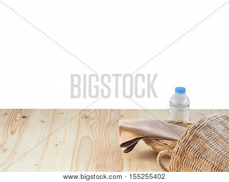 Wicker basket bottle and fabric and fabric on wooden terrace pine. isolated on white background.
