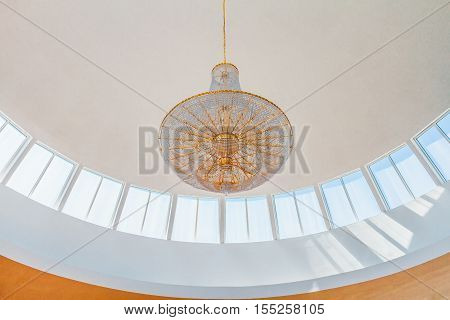 Crystal chandelier hanging from a skylight in a mosque in Argentina